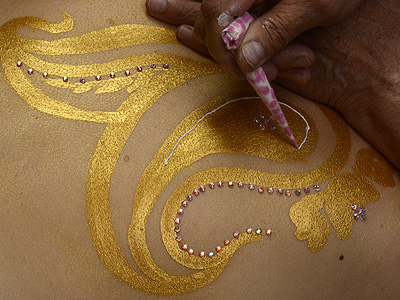 draw into your 'golden henna' with 'white henna' paste