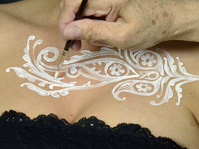 painting white Temptu on skin